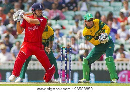 LONDON, ENGLAND - June 19 2013: England's Alastair Cook batting and AB de Villiers (c & wk) during the ICC Champions Trophy semi final match between England and South Africa at The Oval Cricket Ground