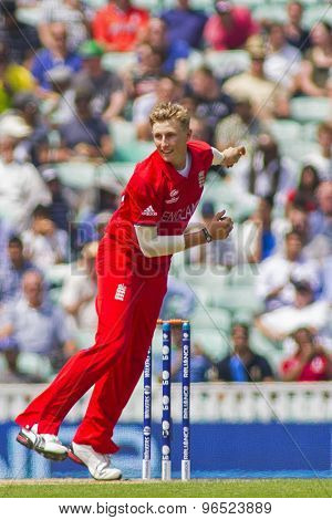 LONDON, ENGLAND - June 19 2013: England's Joe Root bowling during the ICC Champions Trophy semi final match between England and South Africa at The Oval Cricket Ground