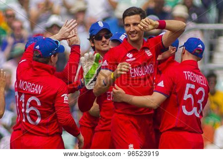 LONDON, ENGLAND - June 19 2013: England's Steven Finn celebrates taking the wicket of Hashim Amla during the ICC Champions Trophy semi final match between England and South Africa