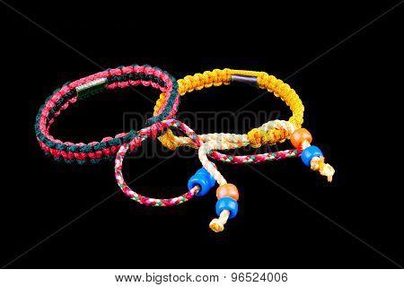 Buddhist Bracelets On Black Background