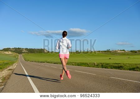 Woman Running On Road