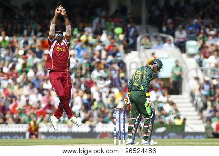 LONDON, ENGLAND - June 07 2013: West Indies Kieron Pollard and Pakistan's Misbah-ul-Haq during the ICC Champions Trophy cricket match between Pakistan and The West Indies at The Oval Cricket Ground.