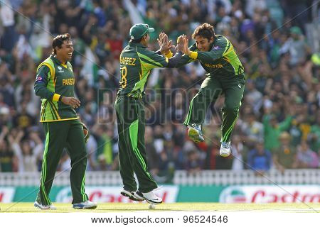 LONDON, ENGLAND - June 07 2013: Pakistan's Saeed Ajmal celebrates taking the wicket of Darren Bravo during the ICC Champions Trophy cricket match between Pakistan and The West Indies