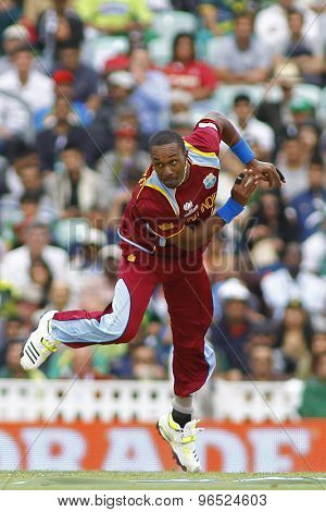 LONDON, ENGLAND - June 07 2013: West Indies Dwayne Bravo bowling during the ICC Champions Trophy cricket match between Pakistan and The West Indies at The Oval Cricket Ground.