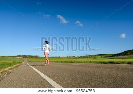 Female Athlete Running On Road