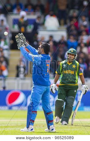 EDGBASTON, ENGLAND - June 15 2013: India's Mahendra Singh Dhoni during the ICC Champions Trophy cricket match between India and Pakistan at Edgbaston Cricket Ground.