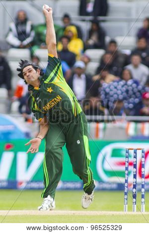 EDGBASTON, ENGLAND - June 15 2013: Pakistan's Mohammad Irfan bowling during the ICC Champions Trophy cricket match between India and Pakistan at Edgbaston Cricket Ground.