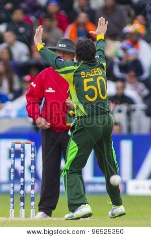 EDGBASTON, ENGLAND - June 15 2013: Pakistan's Saeed Ajmal appeals during the ICC Champions Trophy cricket match between India and Pakistan at Edgbaston Cricket Ground.