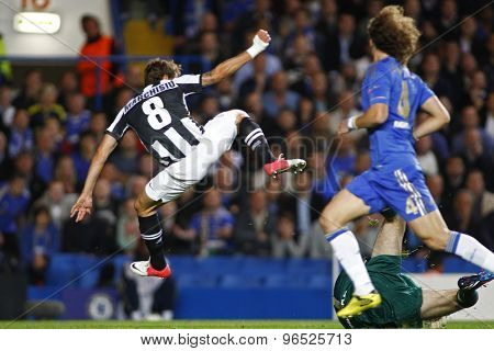 LONDON, ENGLAND. September 19 2012  Juventus's Claudio Marchisio  jumps over Chelsea's goalkeeper Petr Cech during the UEFA Champions League football match between Chelsea and Juventus