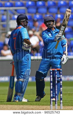 CARDIFF, WALES - June 04 2013: India's Dinesh Karthik celebrates a half century during the ICC Champions Trophy warm up match between India and Australia at the Cardiff Wales Stadium
