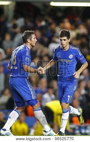 LONDON, ENGLAND. September 19 2012 Chelsea's midfielder Frank Lampard congratulates Chelsea's midfielder Oscar on his goal  during the UEFA Champions League football match between Chelsea and Juventus