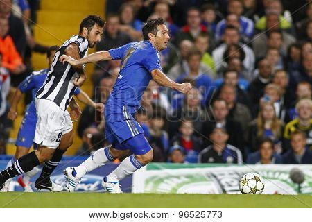 LONDON, ENGLAND. September 19 2012  Juventus's Montenegro forward Mirko Vucinic and Chelsea's midfielder Frank Lampard during the UEFA Champions League football match between Chelsea and Juventus