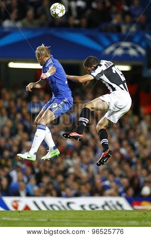 LONDON, ENGLAND. September 19 2012 Chelsea's forward Fernando Torres  and Juventus's Leonardo Bonucci compete for the ball during the UEFA Champions League football match between Chelsea and Juventus