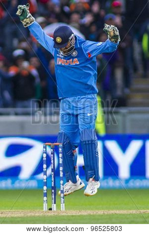 EDGBASTON, ENGLAND - June 23 2013: India's captain Mahendra Singh Dhoni celebrates his team winning the ICC Champions Trophy final cricket match between England and India at Edgbaston Cricket Ground