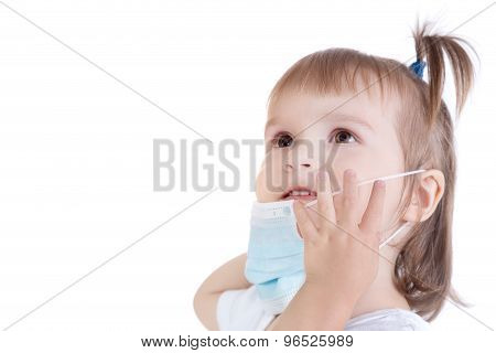Portrait Of Little Girl With Surgical Face Mask For Bacterial And Virus Flu Protection On White Back
