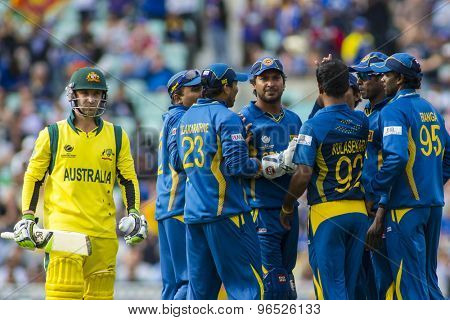 LONDON, ENGLAND - June 17 2013: Sri Lanka celebrates the wicket of Phillip Hughes during the ICC Champions Trophy international cricket match between Sri Lanka and Australia.