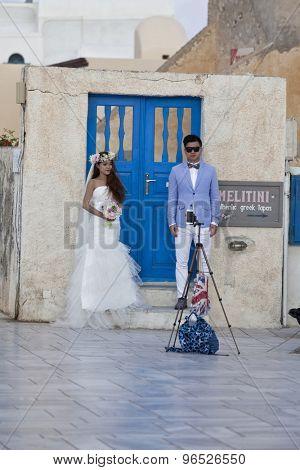 Oia,Santorini, GREECE - June 14, 2015:married couple in formal dress take selfie