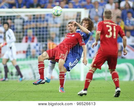 MUNICH, GERMANY May 19 2012. Bayern's forward Thomas Muller Bayern's German midfielder Bastian Schweinsteiger  and Chelsea's defender David Luiz in action during the 2012 UEFA Champions League Final