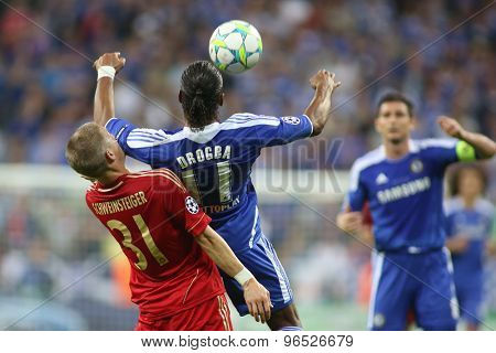 MUNICH, GERMANY May 19 2012. Bayern's German midfielder Bastian Schweinsteiger  and Chelsea's Ivory Coast forward Didier Drogba in action during the 2012 UEFA Champions League Final