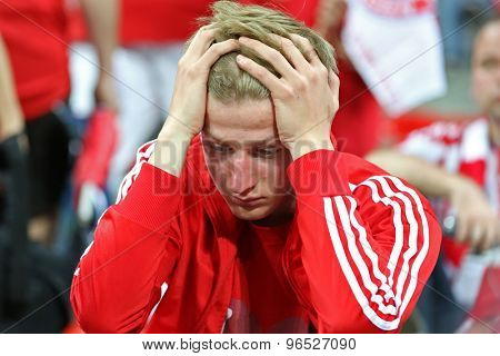 MUNICH, GERMANY May 19 2012. A dejected Bayern fan after his team lost the 2012 UEFA Champions League Final at the Allianz Arena Munich contested by Chelsea and Bayern Munich