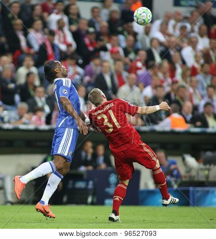 MUNICH, GERMANY May 19 2012. Chelsea's Ivory Coast forward Didier Drogba and Bayern's German midfielder Bastian Schweinsteiger in action during the 2012 UEFA Champions League Final