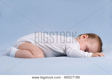 Baby Is Laying Down And Sleeps On Soft Blue Blanket