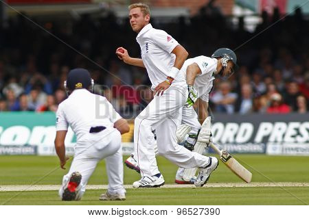 LONDON, ENGLAND. AUGUST 16 2012 England's Stuart Broad fields off his own bowling during the third Investec cricket  test match between England and South Africa, at Lords Cricket Ground