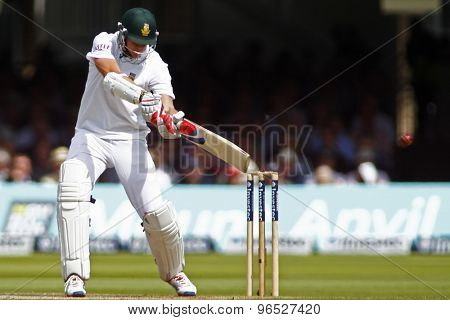 LONDON, ENGLAND. AUGUST 17 2012 South Africa's Morne Morkel hits the ball off England's Steven Finn and is caught out during the third Investec cricket  test match between England and South Africa
