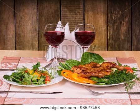 Grilled Chicken Tapakats (tabaka) With Vegetables And Glass Of Red Wine On Table In Wooden Restauran