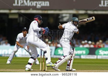 LONDON, ENGLAND. AUGUST 19 2012 South Africa's Hashim Amla hits four runs to go to his century during the third Investec cricket  test match between England and South Africa, at Lords Cricket Ground