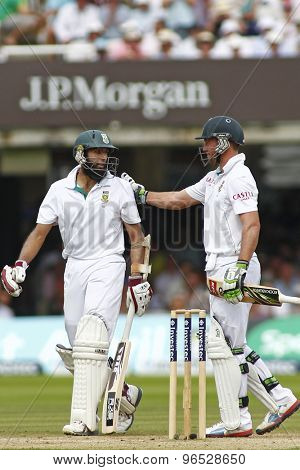 LONDON, ENGLAND. AUGUST 19 2012 South Africa's Hashim Amla gets a pat on the shoulder from AB de Villiers after being dismissed during the third test match between England and South Africa