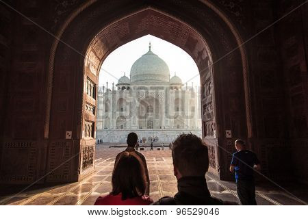 AGRA, INDIA - 28 FEBRUARY 2015: View of Taj Mahal from mosque with people. West side.