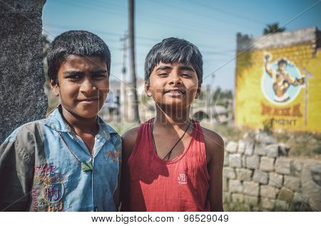 HAMPI, INDIA - 01 FEBRUARY 2015: Two Indian boys in street on a sunny day. Post-processed with grain, texture and colour effect.