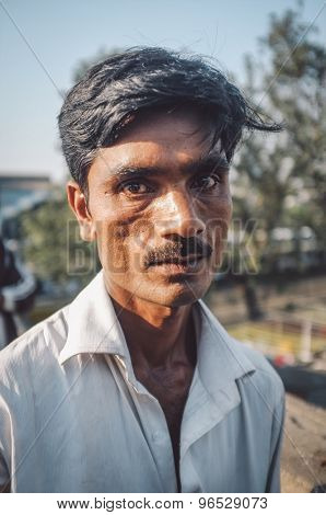 MUMBAI, INDIA - 08 JANUARY 2015: Unidentified Indian man with mustache stands in street. Post-processed with grain, texture and colour effect.