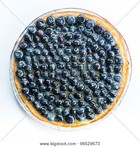Tart with blueberries on a white background. top view
