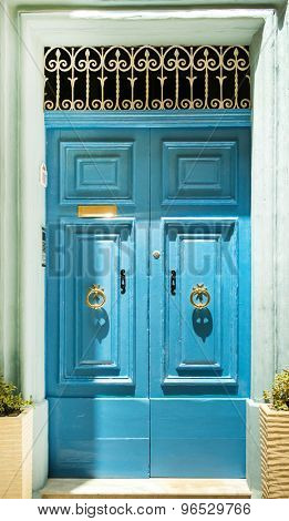 colourful blue front door to house