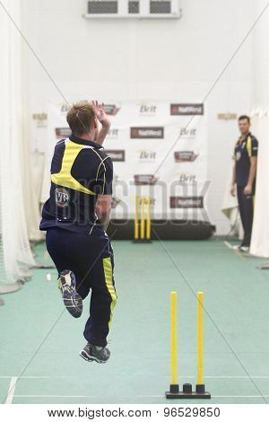 CHESTER LE STREET, ENGLAND. JULY 06 2012: Australia's Brett Lee, bowling with Australia's Clinton McKay, watching on during the official training and net session