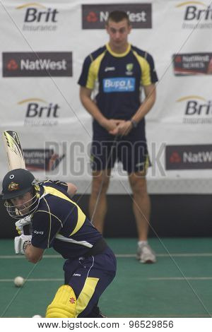 CHESTER LE STREET, ENGLAND. JULY 06 2012: Australia's David Hussey, batting whilst on a tensioned leash held by the Australian team masseuse during the official training and net session