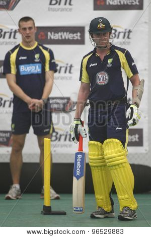CHESTER LE STREET, ENGLAND. JULY 06 2012: Australia's Brett Lee, batting whilst on a tensioned leash held by the Australian team masseuse during the official training and net session prior