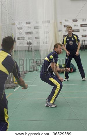 CHESTER LE STREET, ENGLAND. JULY 06 2012: Australia's Brett Lee, gets hit with a tennis ball thrown by Clinton McKay, and watched by George Bailey, during the official training and net session