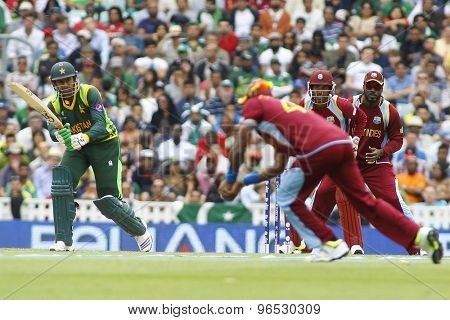 LONDON, ENGLAND - June 07 2013: Pakistan's Shoaib Malik hits the ball to Dwayne Bravo and is dismissed for a duck during the ICC Champions Trophy cricket match between Pakistan and The West Indies