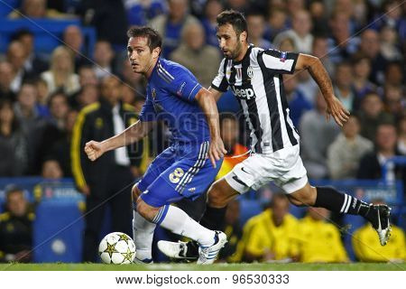 LONDON, ENGLAND. September 19 2012 Chelsea's English midfielder Frank Lampard  and Juventus's forward Mirko Vucinic during the UEFA Champions League football match between Chelsea and Juventus