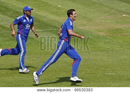 CHESTER LE STREET, ENGLAND. JULY 07 2012: England's Steven Finn, celebrates a wicket with England's Ravi Bopara,  during the 4th one day international between England and Australia