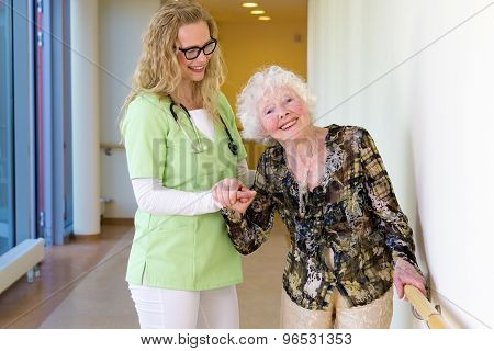 Medical Assistant Assisting Happy Elderly Patient