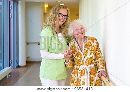 Therapist And Elderly Patient Smiling At Camera