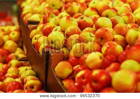 Many Ripe Yellow-red Apples In Boxes In The Store