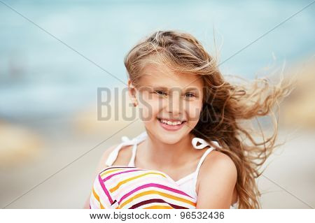 Portrait Of A Pretty Little Girl With Waving In The Wind Long Hair