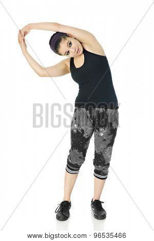 A pretty teen stretching out in her black and white workout clothes.  On a white background.