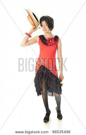 A beautiful young teen dancing in her red and black Cinco de Mayo dress.  On a white background.