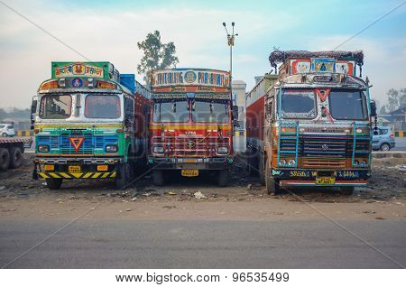 MUMBAI, INDIA - 05 FEBRUARY 2015: Parked trucks on highway rest area decorated in traditional Indian style.